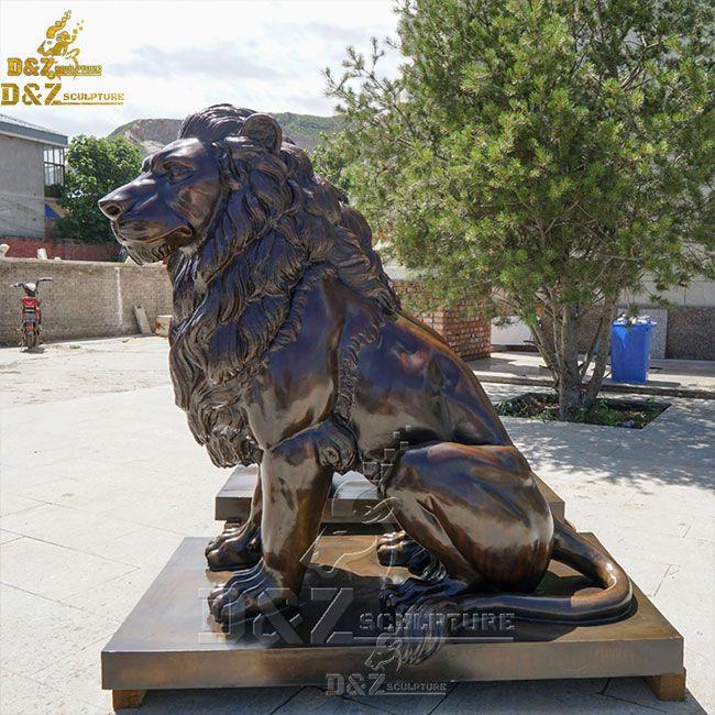 sitting lion garden statue