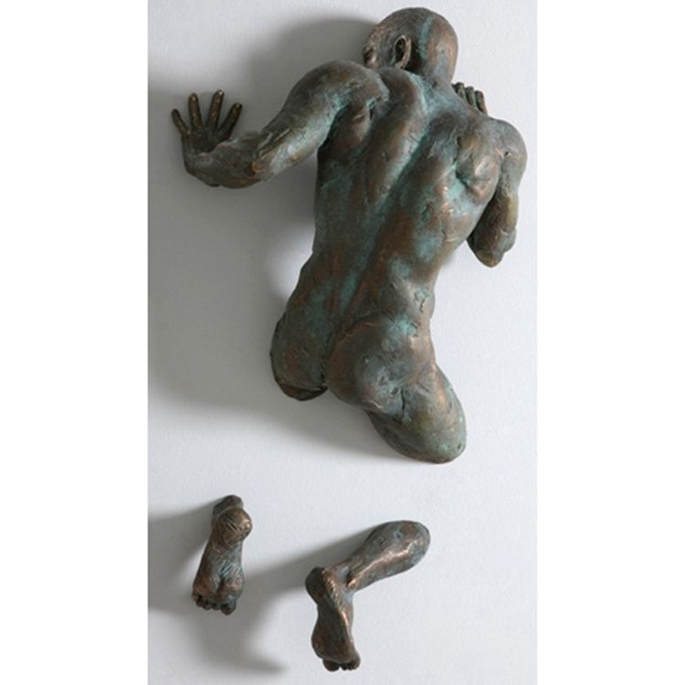 Famous cast bronze figure through wall sculpture