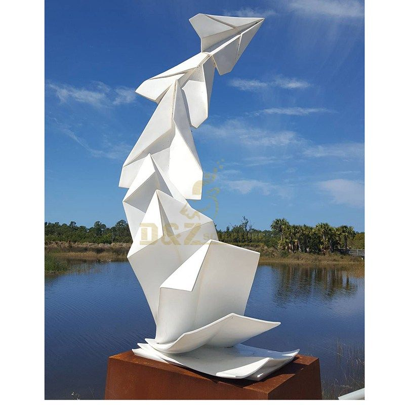 Stainless steel paper airplane sculpture