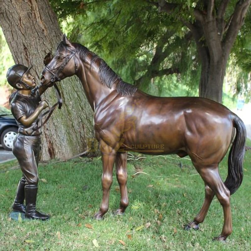 Garden life-size cast bronze boy with horse statue