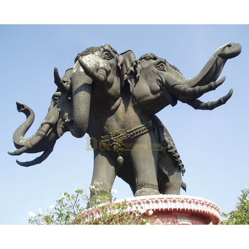 Large outdoor bronze sculpture of three head elephants in modern temple