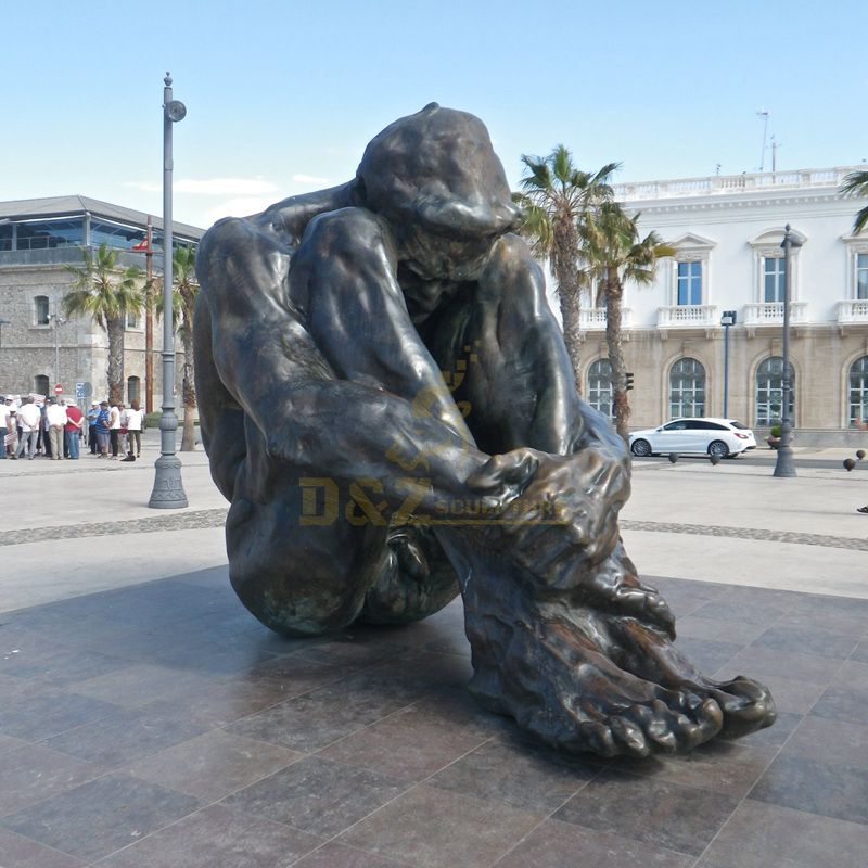 large casting art bronze custom man sitting on the floor sculpture on the square