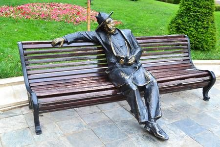 The streets decoration bronze statue sitting man on bench sculpture