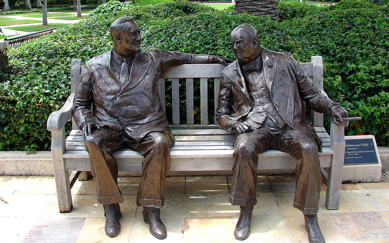 Life size city bronze statues two man siiting on the chair talking with each other