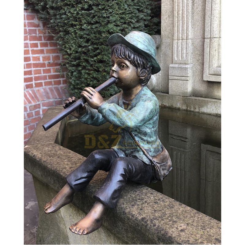 Life size garden decorating outdoor pond using a boy fountain playing the flute