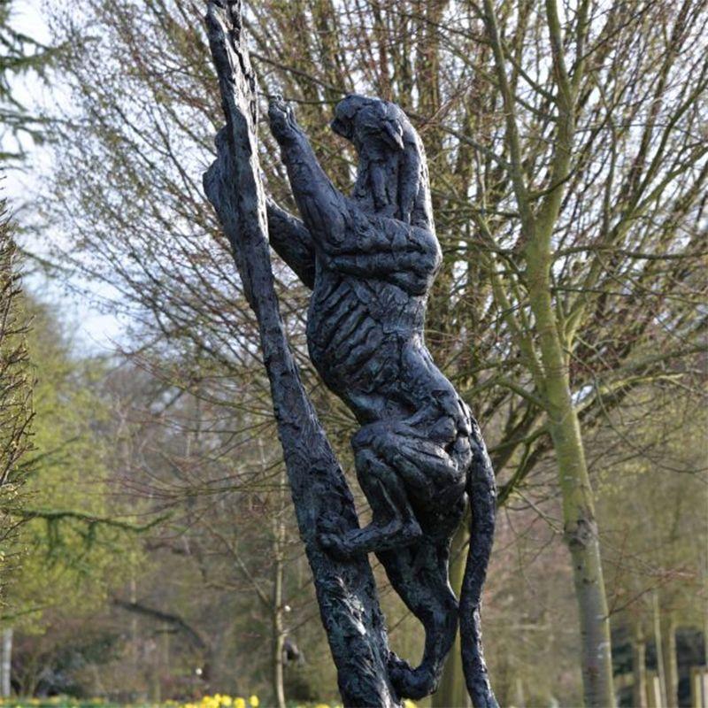 Bronze animal black panther on the tree