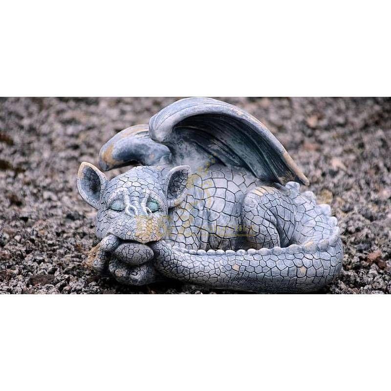 Sleeping baby dragon garden statue