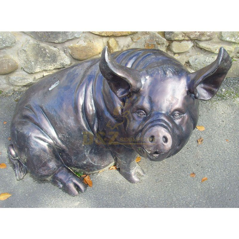brass pigs sculpture