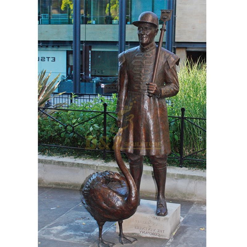 man and swan statue