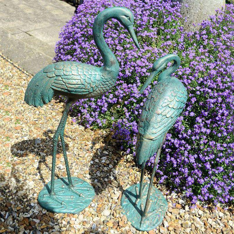 crane garden statues