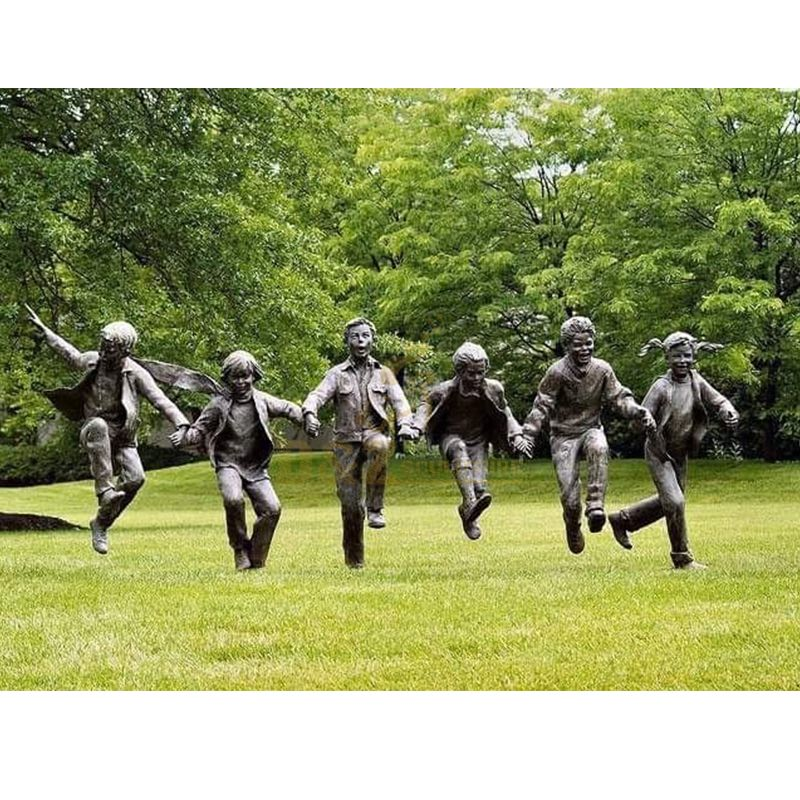 A group of life size children garden statues