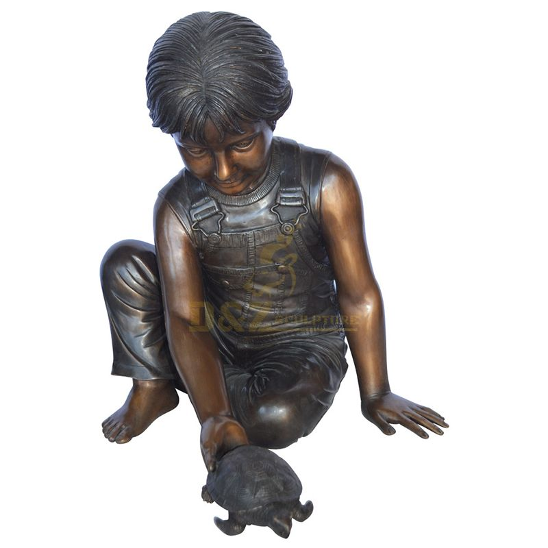 boy with turtle statue