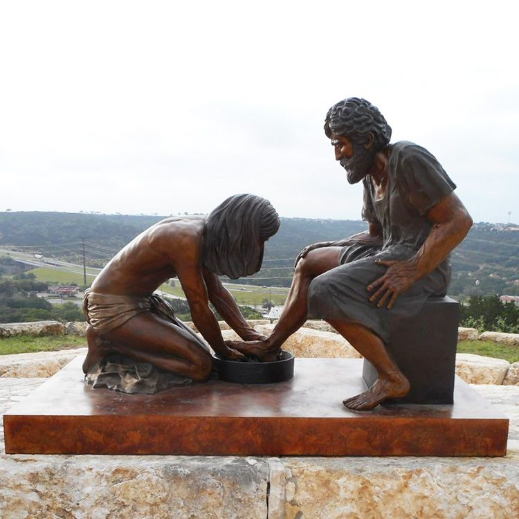 Bronze statue of Jesus washing the disciple Peter's feet