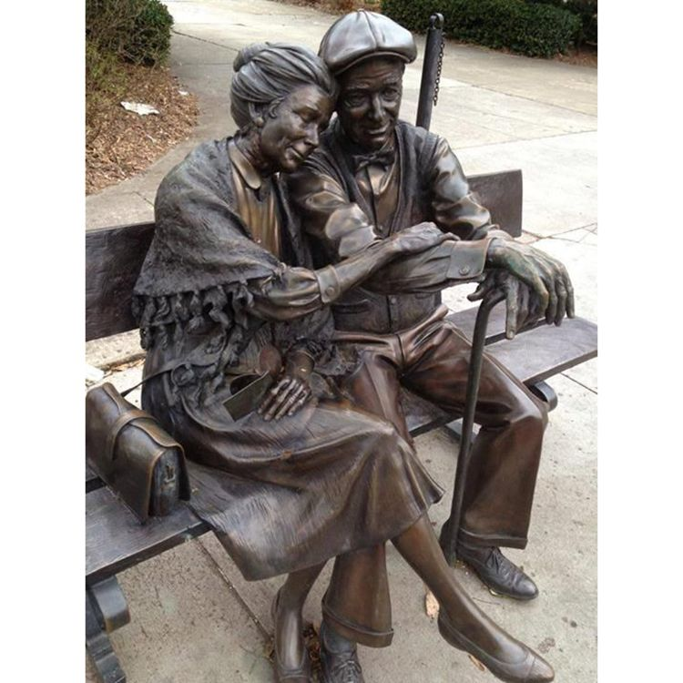 old man and woman garden statue