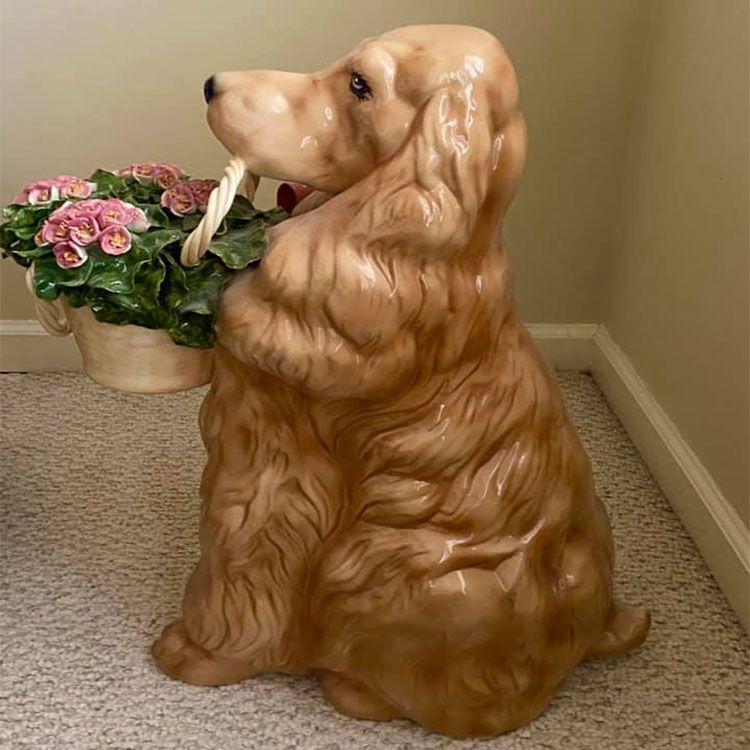 fiberglass dog statue with basket