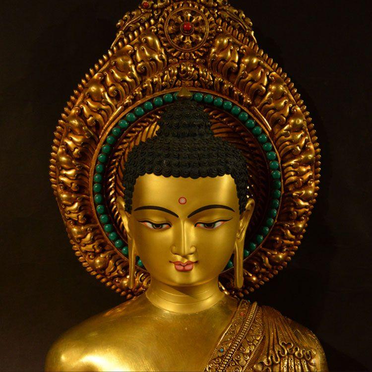 gold buddha head statue