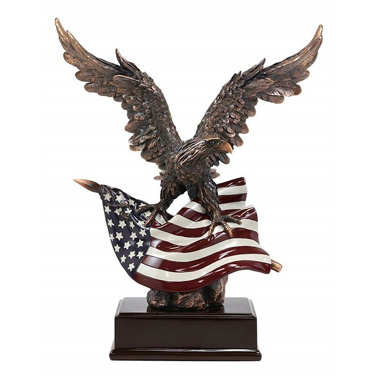 Patriotic bald eagle statue with American flag