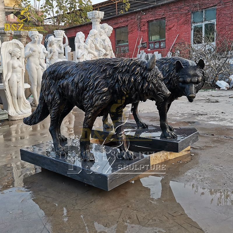 A pair of outdoor life size wolf statues for sale