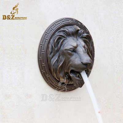 Bronze lion head wall water fountain spout outdoor