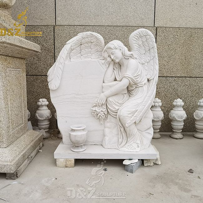cemetery single headstone with angel and angel on tombstone