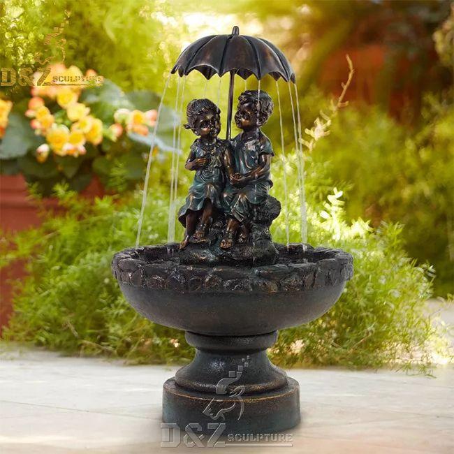 Little boy and girl outdoor umbrella water fountain
