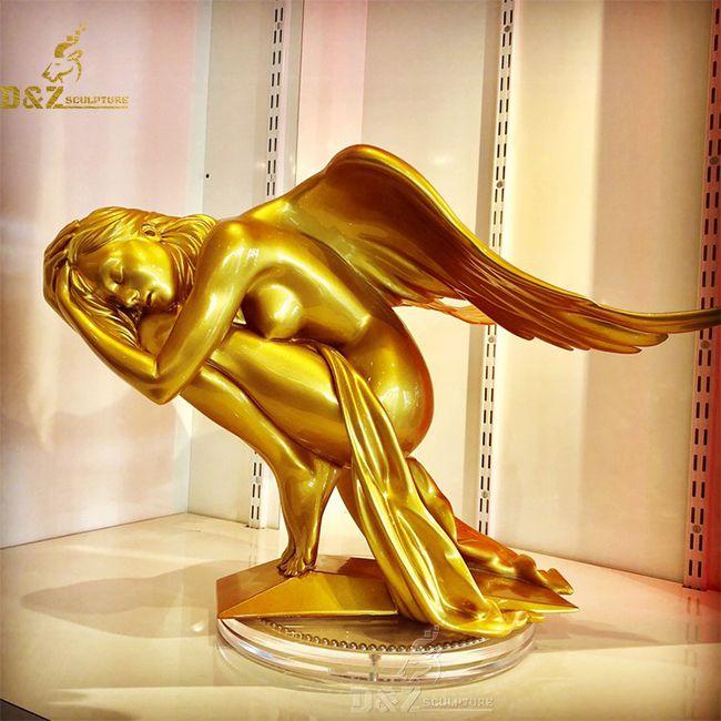 sleeping beauty winged lady angel statue