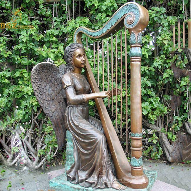 angel playing harp statue