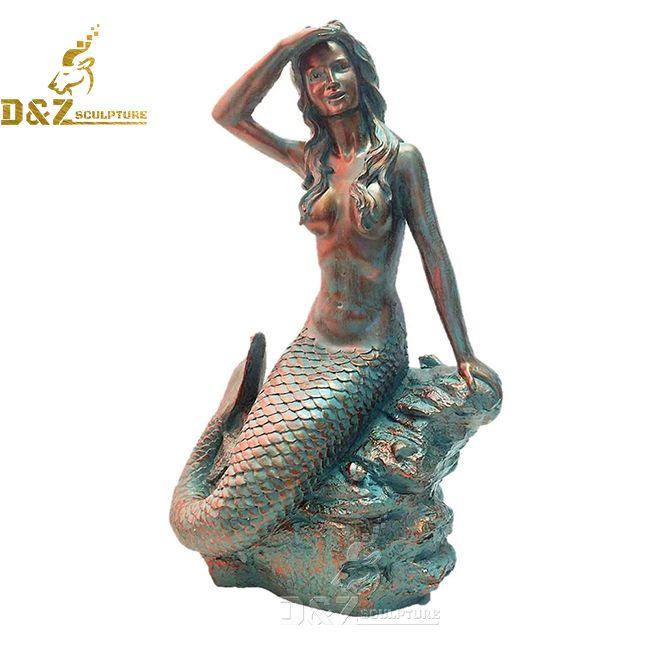 mermaid sitting on a rock statue