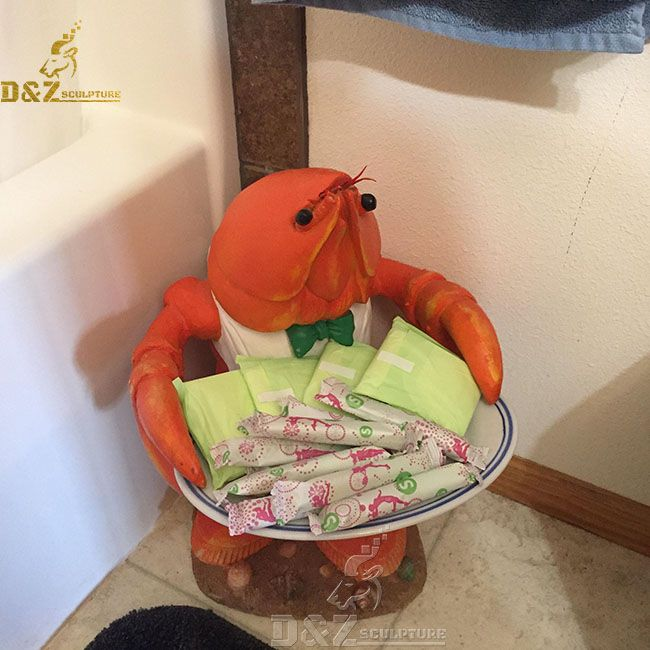 red lobster butler statue holding tray