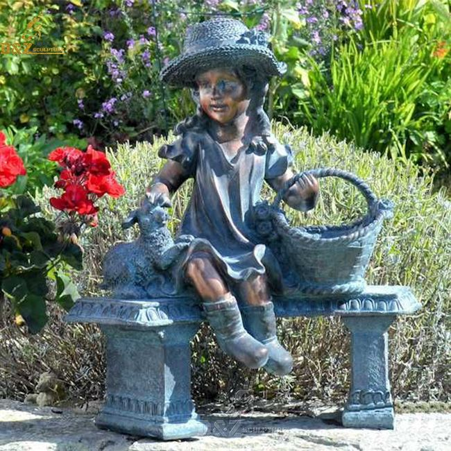 girl on bench with basket garden statue