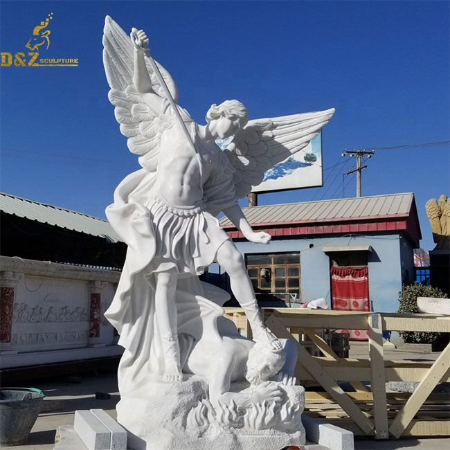 White marble statue of St Michael and the devil