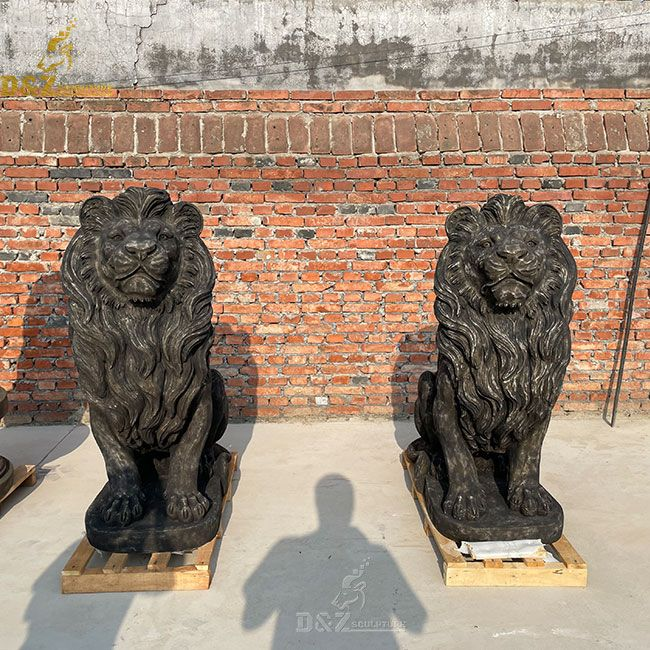 Black antique marble lion statue in front of the house
