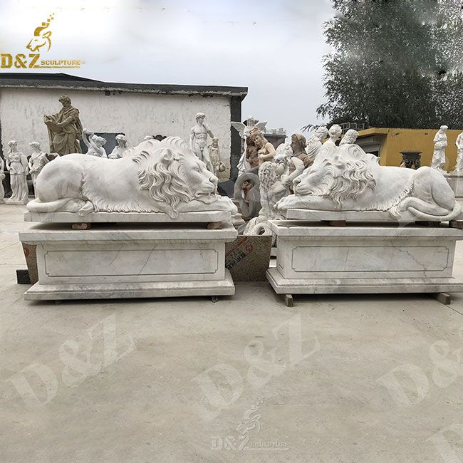 white marble lying and sleeping lion statue