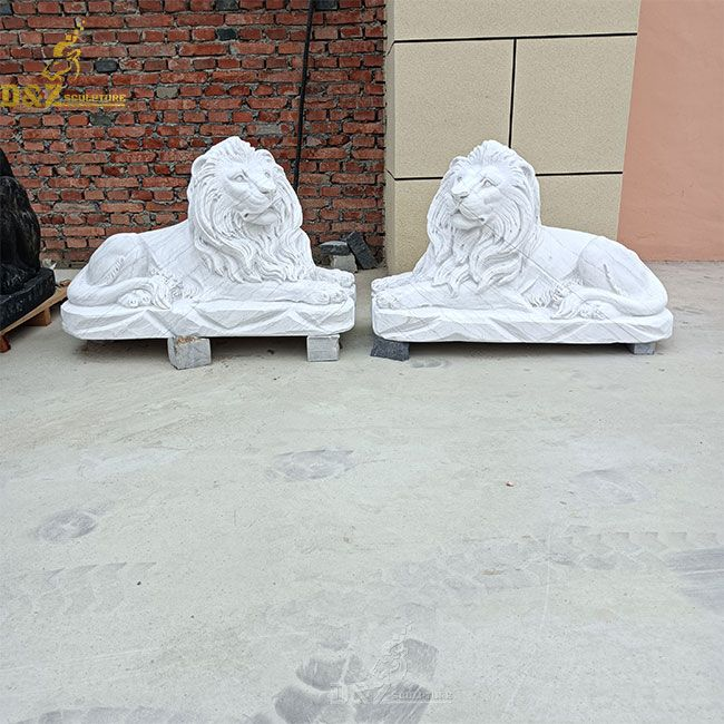 outdoor white lying lion statue pair