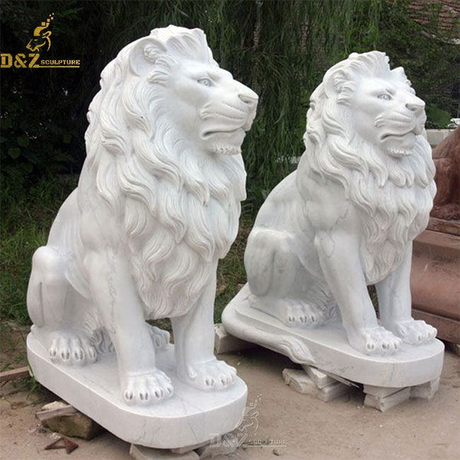 White sitting lion statue pair outside house