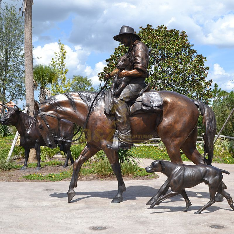 bronze cowboy sculptures with hrose