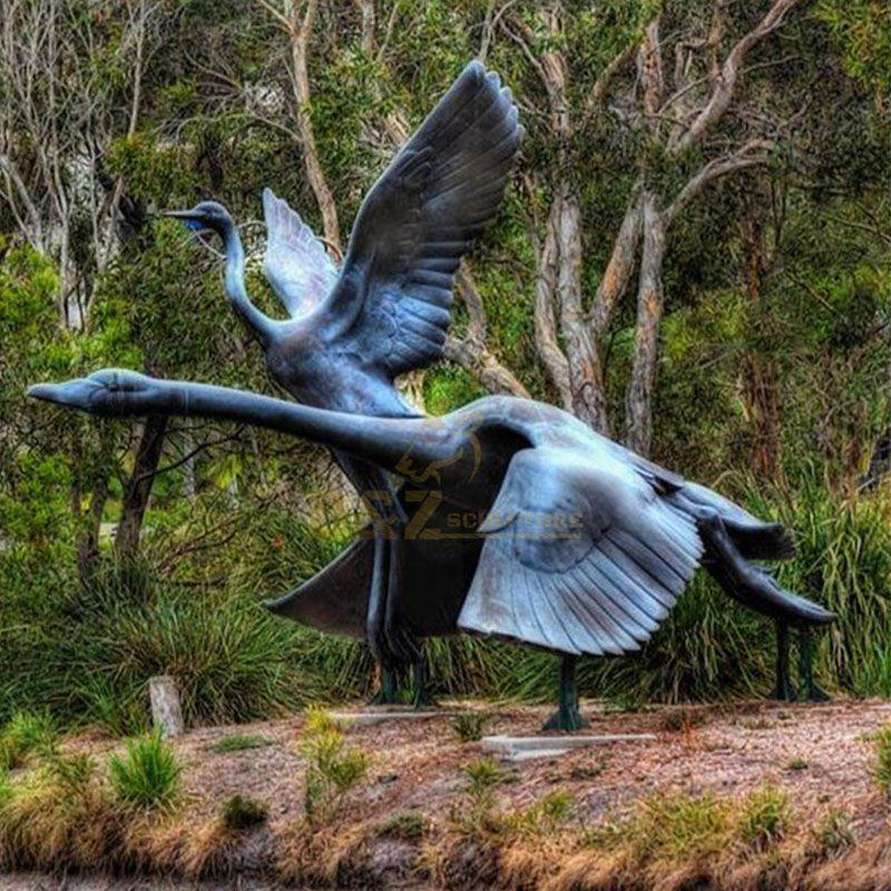 Outdoor bronze flying swan garden bird statue