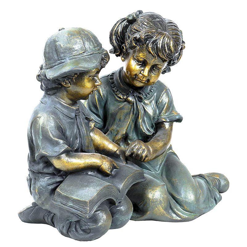 boy and girl garden sculpture