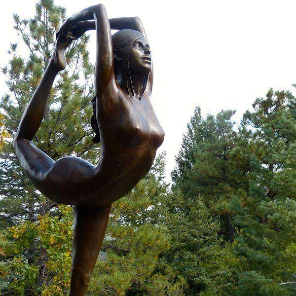 bronze yoga statue
