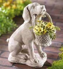 small marble dog with basket garden statue