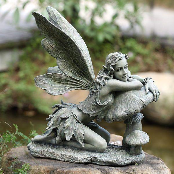 cement fairy statue