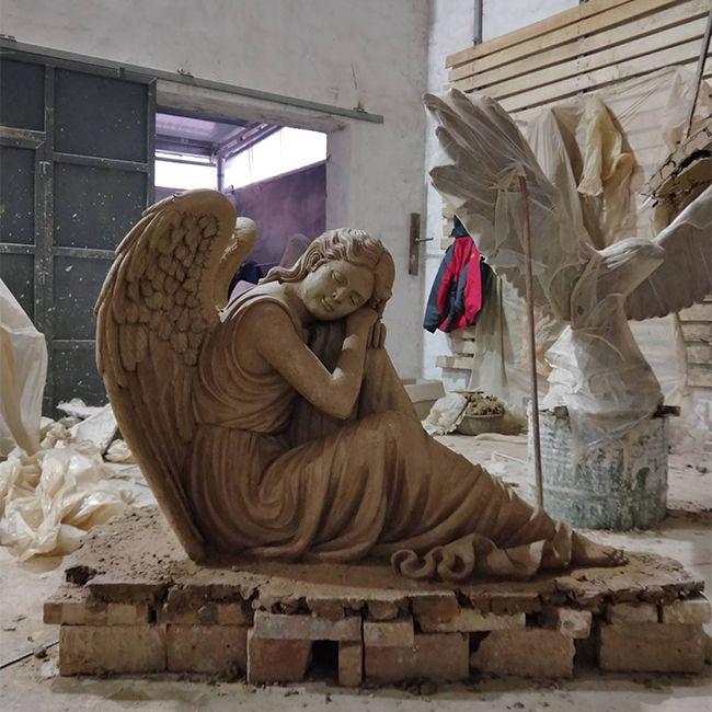clay of sleeping angel statue