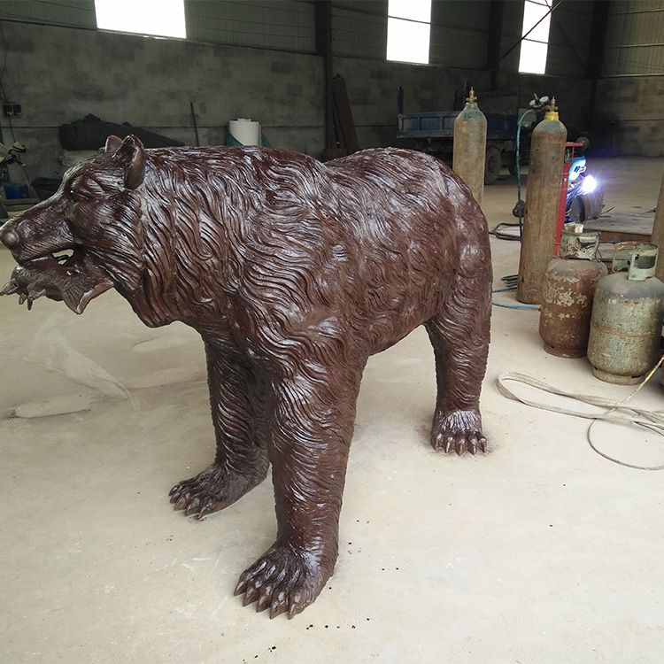 bear catching fish statue