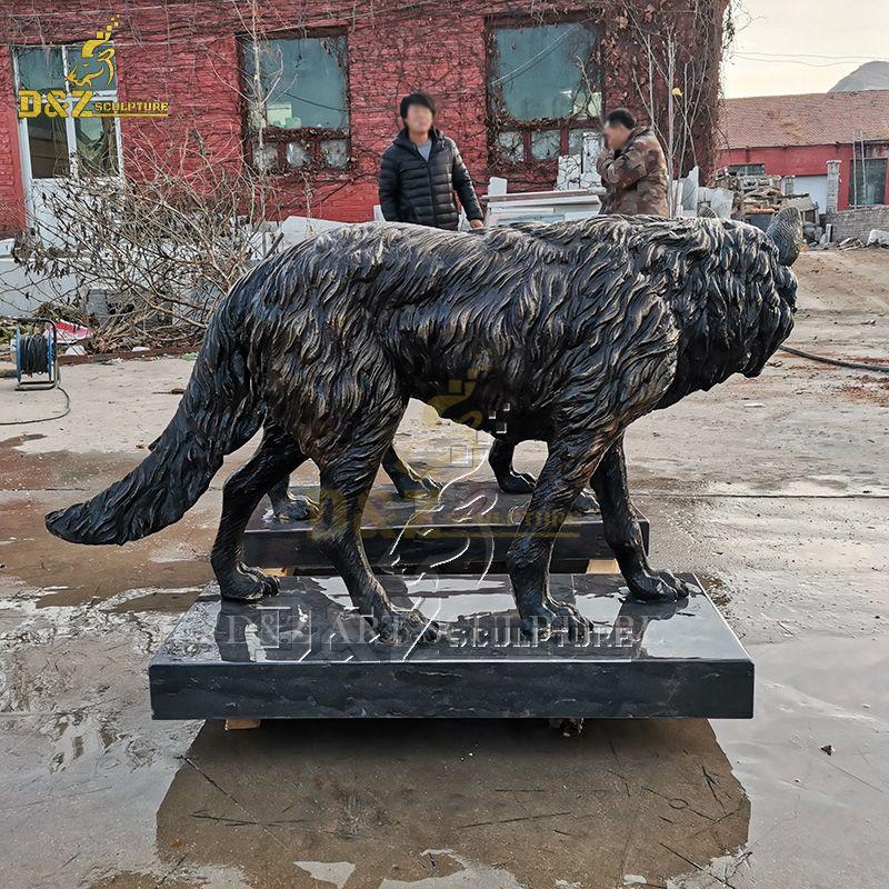 outdoor bronze wolves statue