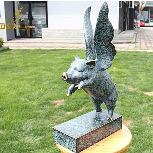 large flying pig statue