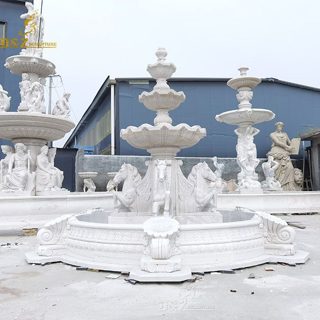 marble fountain with horses